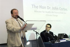 Hon-Minister-of-HeltEnvironmentand-climate-change-Dr.-John-Cortes-speaking